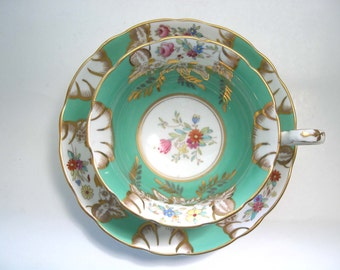 Radfords Fenton  Tea Cup & Saucer, Green and Gold tea cup and saucer set with Spray of Flowers.