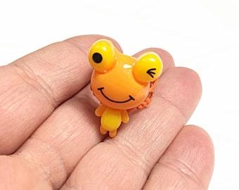 Orange winking frog ring
