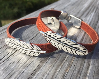 Custom Fitted Silver Feather Charm Bracelet On Embossed Saddle Brown Leather