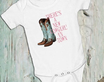 Cowboy boots, There's a new Cowgirl in Town,on White onsie Snap bottom all in one bodysuit