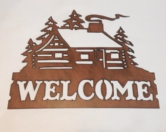 Cabin with smoke welcome sign made out of rusted metal