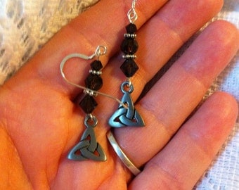 Brown. Mocca brown and silver pierced earrings with Trinity knot charms.
