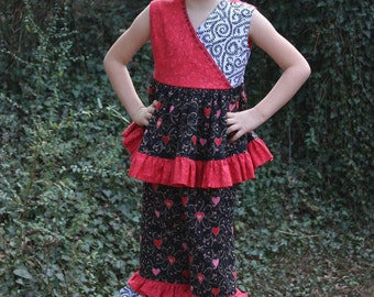 Be Still My Heart. Black and Red Heart Crossover top with ruffled pants.