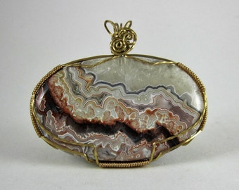 Crazy Lace Agate in Brass wire wrap