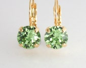 green crystal earrings,peridot crystal earrings,swarovski earrings, rose gold leverback earrings,rose gold earring,august birthstone,peridot