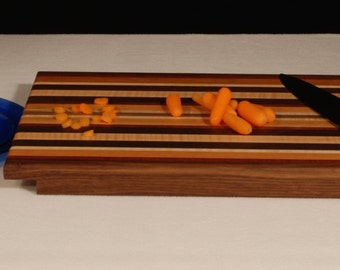 Large cutting board with plate recess and juice groove