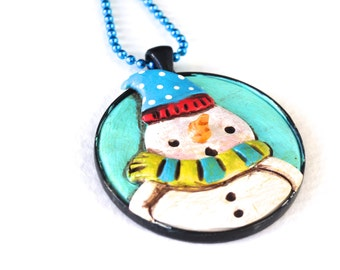 Original Snowman Folk Art Necklace with BLUE Hat in Round Black Bezel setting