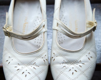 White 1960s shoe with buckle