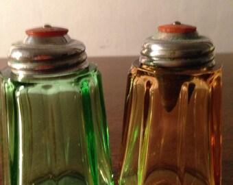 "vintage salt and pepper shakers , green and orange glass , ""kant-klog"" tops"