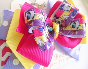 Minnie Mouse and  Daisy inspired  hair bow .  Disney baby hair clip . Minniw and daisy Duck bow 5 inch . Playhouse Disney pink Hair Bow