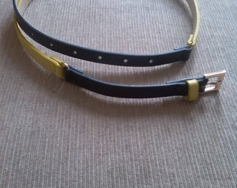 A yellow and navy blue leather belt 1980s (unused)