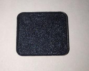 Pressed black/blue eyeshadow
