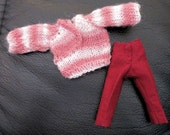 Miniature hand knit wearable pink and white sweater for 1:12 scale Heidi doll, red trousers pants. Handmade in USA.