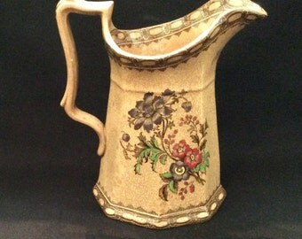 Brown Transferware Pitcher With Brown Background