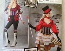 Simplicity 1301, woman's corsets, woman's puffy sleeved shirt, skirt, spats, pants and accessories, womens costume pattern