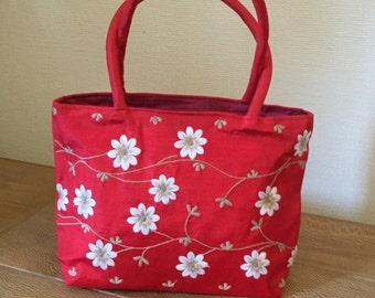 Embroidered, red taffeta daisy handbag