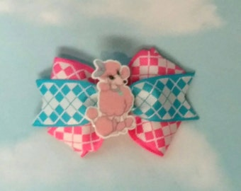 Poodle pink and blue hair bow on lined alligator clip