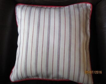 Reversible throw pillow white, blue with red cording