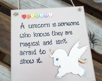 """A UNICORN IS... someone who knows they are magical and isn't afraid to show it. [8""""x8"""" hanging wall plaque]"""