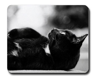 Black cat daydreamer mousepad