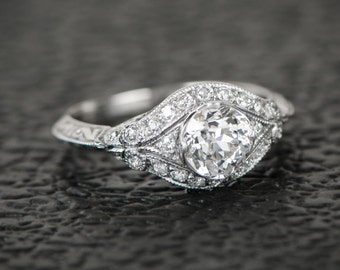 1.02ct Old European Cut Diamond Engagement Ring. Handcrafted Platinum Mounting. Adorned with diamonds.