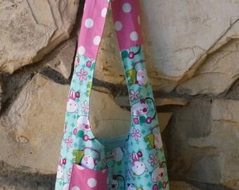 Girls hobo bag. Hobo jr. Bag. Aqua and pink kitty print. This is an across the body hobo bag. Reversible. book bag, slouch bag, girl's bag.