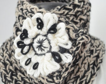 Neck warmer, scarf for winter in wool, black and white with pin-shaped flower