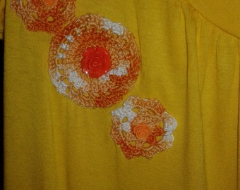 yellow jersey with crochet applications
