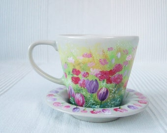 Hand-painted tea cup with meadow