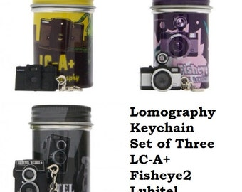 Set of original 3 Lomographic Society Camera Key chain Cameras in unique cannisters