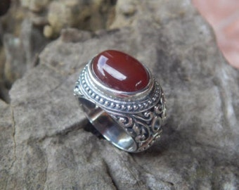 Silver ring bali carving with carnelian stone