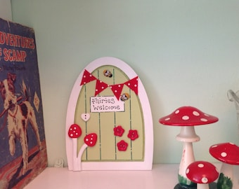 Fairy door with tiny letter from the fairies