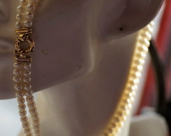 Ref: 152 - Double strand freshwater pearls and 18kt gold crab clasp.