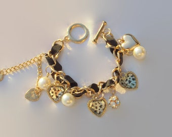 Gold Bracelet black ribbon, beads white and charms