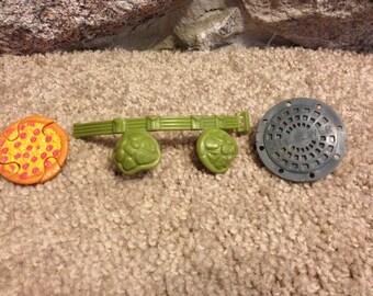 Vintage TMNT Teenage Mutant Ninja Turtles Action Figure Weapons Lot- 1980s Rocksteady shield, belt, and don's ninja star