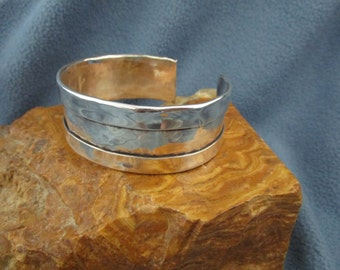 Sterling Silver Cuff Bracelet with Multi Pinged Hammer Textured Center and Folded Sides
