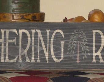 GATHERING ROOM sign with willow tree