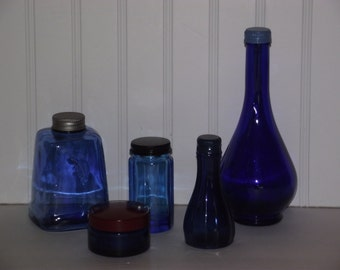 Five blue/cobalt blue bottles, (two vintage) all with newly painted metal caps & in good condition.