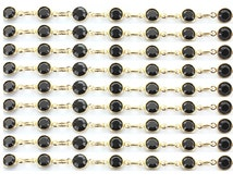 Swarovski vintage 6mm (SS29) channel chain.  Jet stones and gold plated settings.  Price is for 1 foot (12 inches)