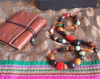 Boho Necklace made with ceramic, seeds, wood, acrylic and metal beads.
