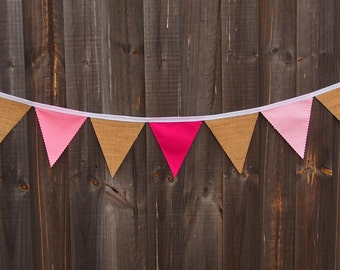 Rustic burlap and pink cotton bunting.