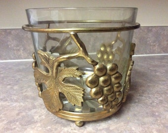A Brass & Glass Wine Cooler Bucket with Grape Clusters and Leaves Design on the Open Frame Stand.
