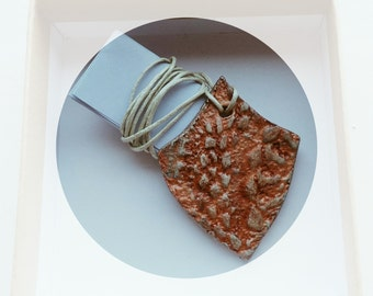 Ceramic doily pendant shield for courage