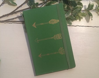 Green and gold arrow hard cover notebook