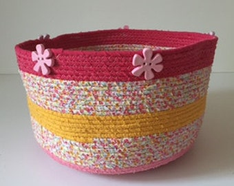 Tall summer coiled basket with flower embellishment