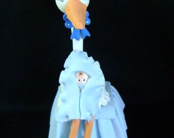 Stork cake birth.