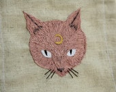 Pink cat with crescent moon hand embroidered patch, witch fiber art