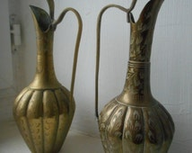 two vintage decorative irregular shaped Indian brass vases with engraved design