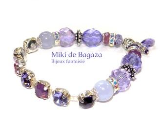Purple elastic bracelet with pearls charm