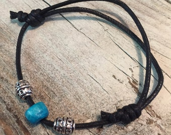 Leather cord w/ blue and silver charm